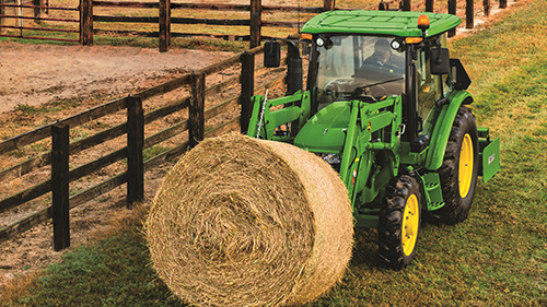 5 Series Tractors are built tough- perfect for moving hay bales around the farm!